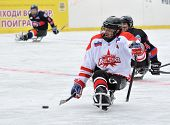 Three Players Playing Sledge Hockey
