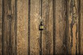 image of lock  - wood panels background with lock in the middle  - JPG