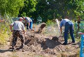 Gravediggers Digging The Grave In Bestuzhevo Village