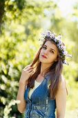 pretty young woman with flower wreath on her head