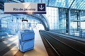 Departure For Rio De Janeiro, Brazil. Blue Suitcase At The Railway Station