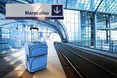 Departure For Maracaibo, Venezuela. Blue Suitcase At The Railway Station