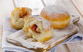 Sweet Homemade Donuts On A Wooden Table.