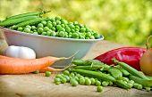 Fresh organic peas in bowl