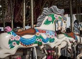stock photo of merry-go-round  - Merry go around horse at a country fair in the United States - JPG