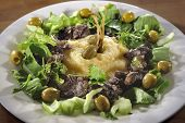 stock photo of liver fry  - Fried chicken liver with polenta caperberries herbs and olives - JPG