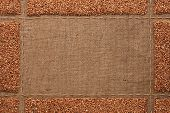 stock photo of sackcloth  - Beautiful frame with buckwheat on sackcloth with place for your text drawing - JPG