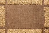 image of sackcloth  - Beautiful frame with oats on sackcloth with place for your text drawing - JPG