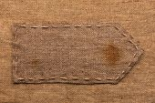 Arrow Of Burlap, Lies On A Background Of Burlap