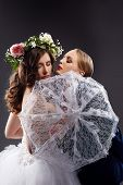 Homosexual girlfriends posing in wedding costumes