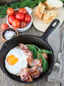 Fried Eggs With Bacon On A Frying Pan