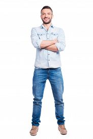 pic of denim wear  - Full length of handsome young man in casual wear keeping arms crossed and smiling while standing isolated on white background - JPG