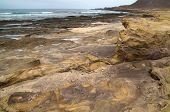 image of naturist  - Gran Canaria El Confital beach at the edge of Las Palmas eroded sandstone patterns - JPG