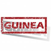 stock photo of guinea  - Outlined red stamp with country name Guinea - JPG