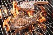 pic of flame-grilled  - Grilled pork steaks over flames on the grill - JPG