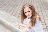 pic of pullovers  - Outdoor portrait of a cute little girl in a city - JPG