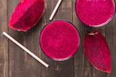 stock photo of dragon fruit  - Red dragon fruit smoothie on wooden background  - JPG