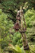stock photo of pulley  - Large old steel pulley with a bug steel chain on a post - JPG