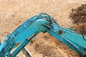 pic of excavator  - arm of excavator tractor working in construction site - JPG
