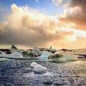 image of iceberg  - Icebergs floating in Jokulsarlon Lagoon by the southern coast of Iceland - JPG