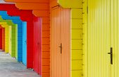 stock photo of beach hut  - colourful paint wooden Victorian beach hut at the seaside - JPG