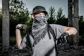 picture of anarchists  - Man holding big stone in a hand - JPG