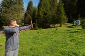 stock photo of longbow  - A man shoots a bow - JPG