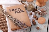 stock photo of roughage  - Dry lavender with nutmeg and book on table close up - JPG