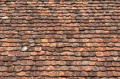 picture of red roof  - Detail shot of a roof area with very old roof tiles in various red brown shades - JPG