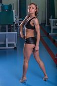 picture of breast-pump  - Girl pumps the major muscle groups in the gym - JPG
