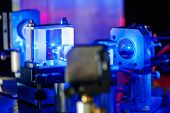foto of laser beam  - Blue laser on optical table in a quantum optics lab - JPG
