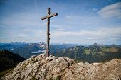 stock photo of bavarian alps  - Summit cross in the Bavarian Alps near Lake Schliersee