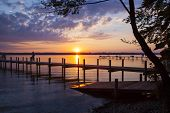 stock photo of jetties  - Reflections and jetty at Lake Starnberg  in the evening light - JPG