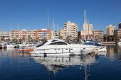 stock photo of marina  - Luxury yachts and motorboats in the marina of Puerto de Mazarron province of Murcia Spain - JPG