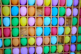 stock photo of game-cock  - darts shooting gallery with colorful balloons - JPG