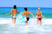 foto of beach holiday  - Portrait of joyful group of people having fun in the sea and laughing - JPG