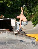Teen Skater Grabbing Board