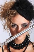 foto of transverse  - Portrait of a fashion woman with transverse flute - JPG