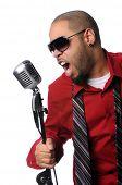 African American singer singing into vintage microphone