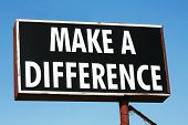 pic of helping others  - Black Make a Difference Sign against clear blue sky - JPG