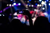 Постер, плакат: People Taking Photographs With Touch Smart Phone During A Music Entertainment Public Concert