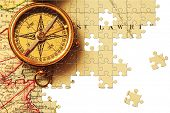 Puzzle Antique brass compass over old Canadian map background
