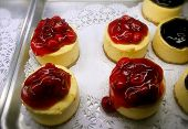 Miniature Berry Cheesecakes In Bakery Display