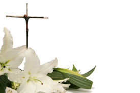 stock photo of christian cross  - Cross and white easter lilies on a white background - JPG