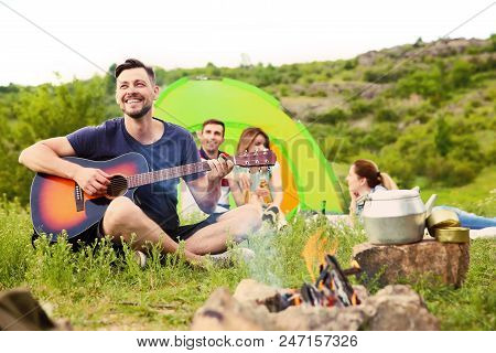 Man Playing Guitar Near Camping