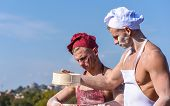 Team Of Attractive Bakers Works With Flour, Preparing Dough. Bakers In Hats And Aprons Works With Si poster