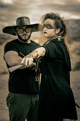 In A Post-apocalyptic Desert Wasteland, Two Queens Lead Their Militias Against Each Other. Armed To  poster