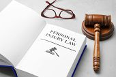 Book With Words Personal Injury Law, Gavel And Glasses On Grey Background poster
