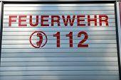 Back Of A German Fire Truck With The Telephone Code Of Emergency