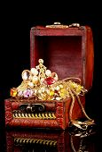 image of treasure chest  - Wooden chest full of gold jewelry on black background - JPG